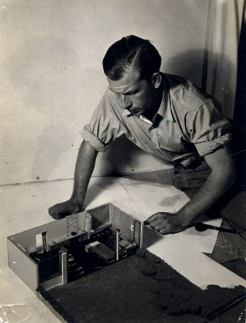 Eero Saarinen with A Combined Living-Dining-Room-Study project Model, Circa 1937