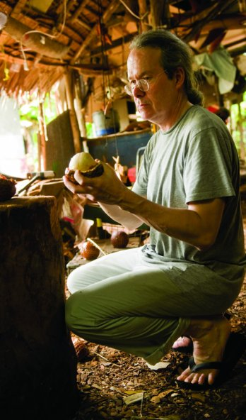 Ted Muehling looks at ivory palm nuts in a carving hut on the Micronesian island of Pohnpei_Ami Vitale
