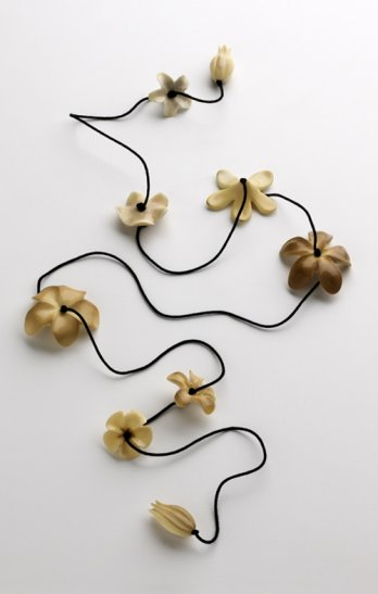 Muehling created a lei by stringing flowers made from vegetable ivory on a black silk cord_Dan Whipps