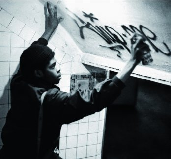 Flip One Spraying his name in New York City's underground subway system, 1974_Flint Gennari